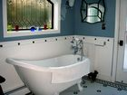 Complete Bathroom Remodel with clawfoot tub and arched window