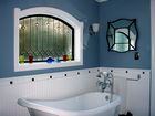 Complete Bathroom Remodel with focus on arched window