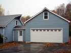 Painted Garage Addition with siding and roof extension blended into house